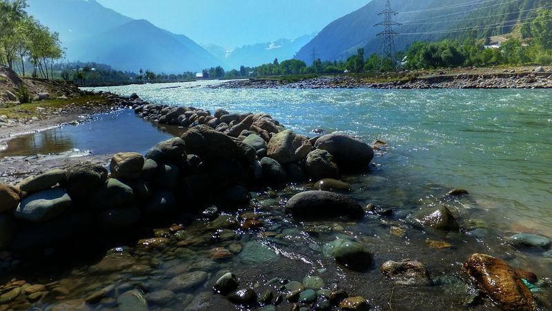 Beauty In Nature Blue Calm Idyllic Landscape Mountain Mountain Range Mountain River And Sky Nature No People Non Urban Scene Non-urban Scene Outdoors Remote Rippled Rock Rock - Object Rock In River Scenics Sky Stone - Object Tranquil Scene Tranquility 43 Golden Moments Fine Art Photography