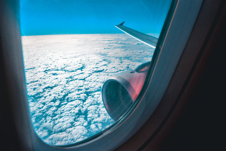 Air Vehicle Mode Of Transportation Airplane Transportation Flying Window Vehicle Interior Glass - Material Travel Aircraft Wing Sky on the move Motion Aerial View Nature No People Mid-air Transparent Journey Cloud - Sky Outdoors
