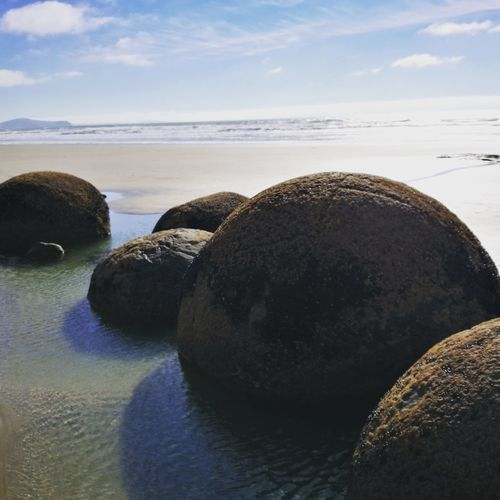 Moeraki Boulders New Zealand Newzealandfinds Beach Walk Adventuring New Zealand Scenery New Zealand Moeraki Moeraki Boulders Outdoors Boulderclimbing Beautiful Place Lovelybeaches Newzealandrocks Beach Beauty In Nature Nature Cloud - Sky Sea EyeEmNewHere