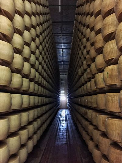 Beautifully Organized This is what you find visiting a caseificio (cheese factory) in the Reggio Emilia province (Italy): hundreds of Parmigiano Reggiano beautifully stocked! Parmigiano Parmigianoreggiano Cheese Parmesan Caseificio Cheese Factory Reggio Emilia Simmetry Italy Slow Food Food