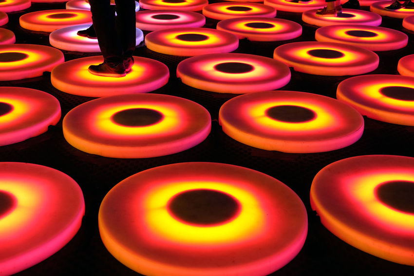 Light Festival Arrangement Beautifully Organized Color Slices Colorful Lamps Colorful Rings Colours Human Leg And Shoe Large Group Of Objects Light Festival One Person People Standing On Lamps People Standning Red Red-organge Colour Slices Yellow