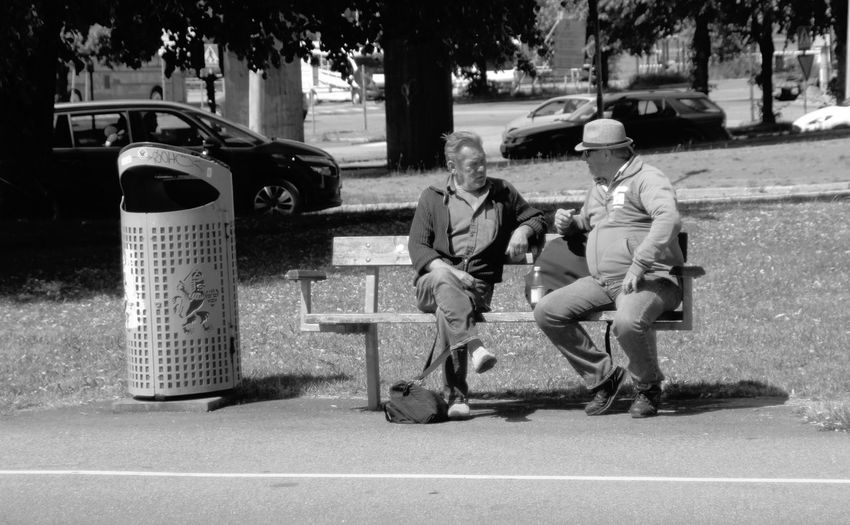 Solving things Sweden Talking Pictures Real People Blackandwhite Summertime EyeEm Selects Garbage Bin Bench Two People Tree Togetherness Men City Friendship Street Focus On Shadow Paved Sidewalk Park Bench Recycling Bin Garbage Can Wastepaper Basket Bus Stop Pavement