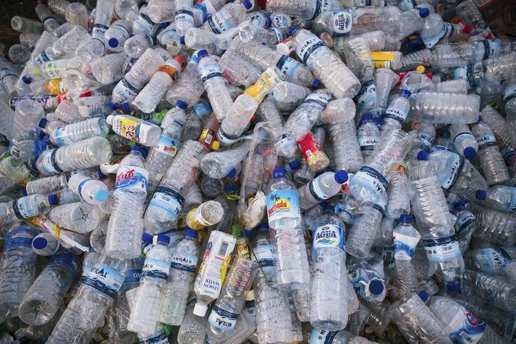 Full frame shot of plastic bottles at junkyard