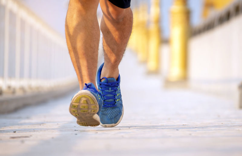 Exercising Healthy Lifestyle One Person Sport Human Body Part Lifestyles Body Part Athlete Running Low Section Sports Training Limb Human Limb Human Leg Vitality Adult Shoe Day Muscular Build Footpath Outdoors Effort Sole Of Shoe Human Foot Running Walking Exercising