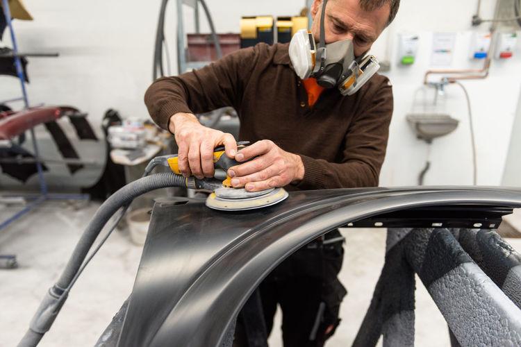 Engineer making car in workshop