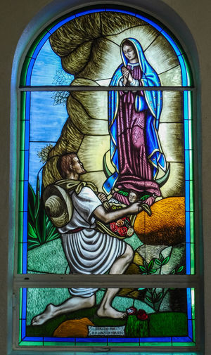 San Lorenzo, Catholic Church, Clint Texas. Saint Lorenzo is the Patron Saint of Cooks Representation Human Representation Art And Craft Religion Creativity Belief Spirituality Indoors  Glass - Material Female Likeness No People Male Likeness Place Of Worship Stained Glass Architecture Multi Colored Window Glass