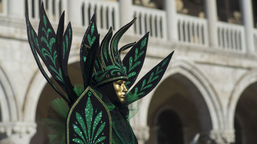 Person wearing costume and mask during carnival of venice