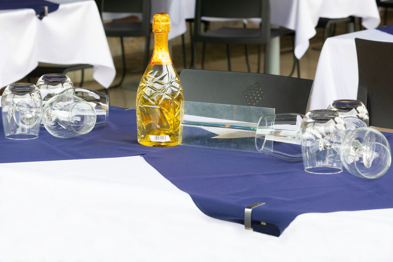 Close-up of glass bottles on table in restaurant