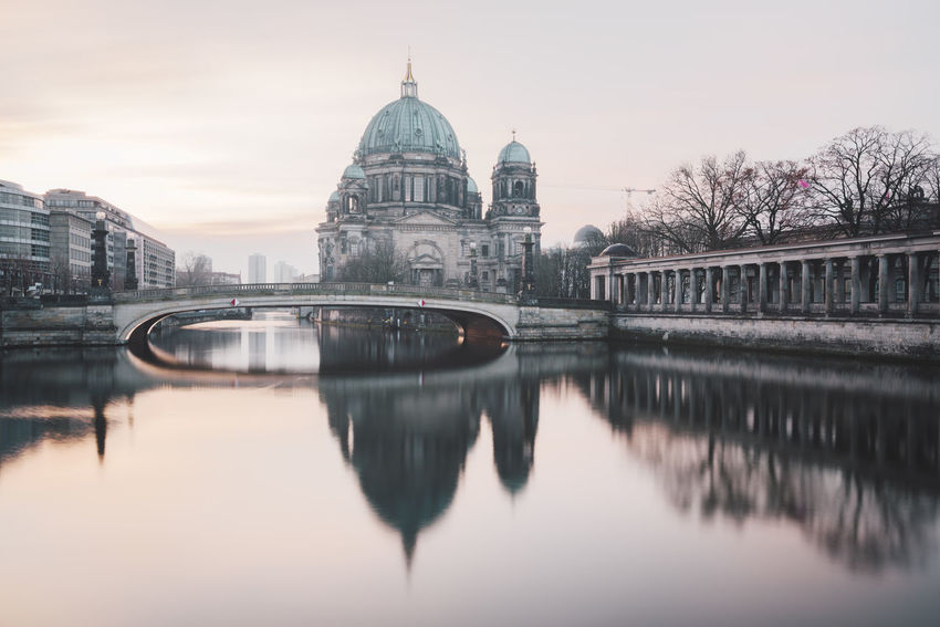 view on the Berlin Cathedral during a winter sunrise Berlin Berlin Cathedral Berliner Dom Copy Space Winter Architecture Bridge - Man Made Structure Building Exterior Built Structure City Day Dome Museum Island Berlin No People Outdoors Philipp Dase Reflection Sky Spree River Sunrise Travel Destinations Water Waterfront Winter Season