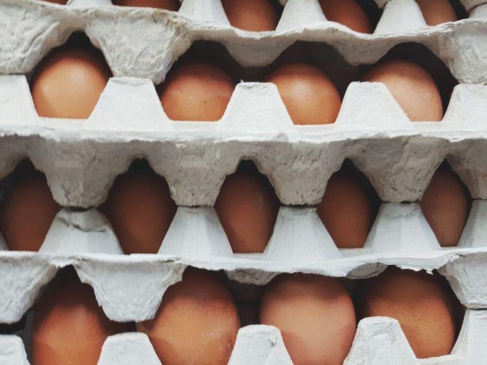 Full frame shot of eggs in cartons