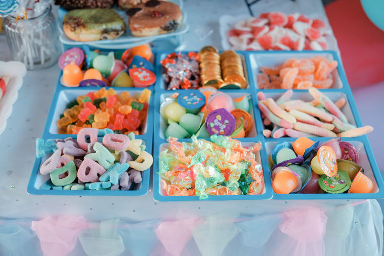 High angle view of multi colored candies in box on table