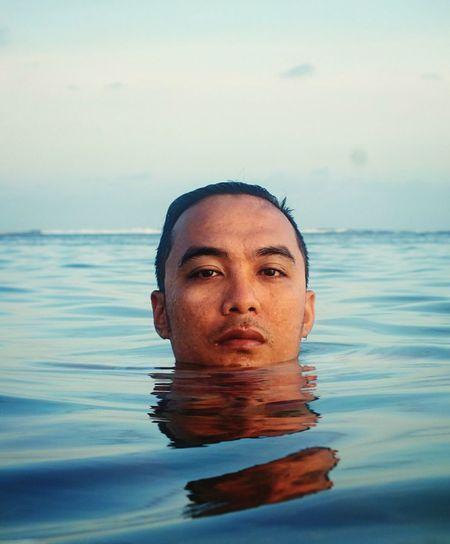 Portrait of man in infinity swimming pool