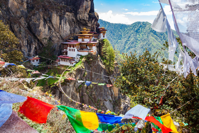 View of Taktshang Monastery on the mountain in Paro, Bhutan Ancient Architecture Beautiful Nature Bhutanese Architecture Himalayas Monastery Taktsang Monastery Tiger's Nest Bhutan Buddhism Buddhist Temple Cliff Colorful Daylight Landmark Landscape Mountain Old Buildings Paro Prayer Flags  Rock - Object Sunny Day Temple Tourism Travel Destinations