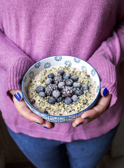 Girl with breakfast porridge Berries Breakfast Porridge Winter Bowl Food Foodphotography Fruits Healthy Eating Müsli One Person