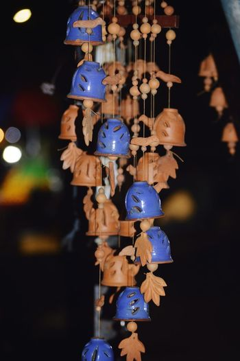Close-up of toys hanging at market stall