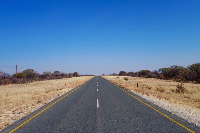 Probably the most booring landscape in Namibia (if you drive 5hours a day like we did). Blue Clear Sky Copy Space Country Road Day Diminishing Perspective Dividing Line Empty Road Landscape Long Nature Non-urban Scene Outdoors Remote Road Road Marking Scenics Solitude Straight Surface Level The Way Forward Tranquil Scene Tranquility Transportation Vanishing Point Finding New Frontiers