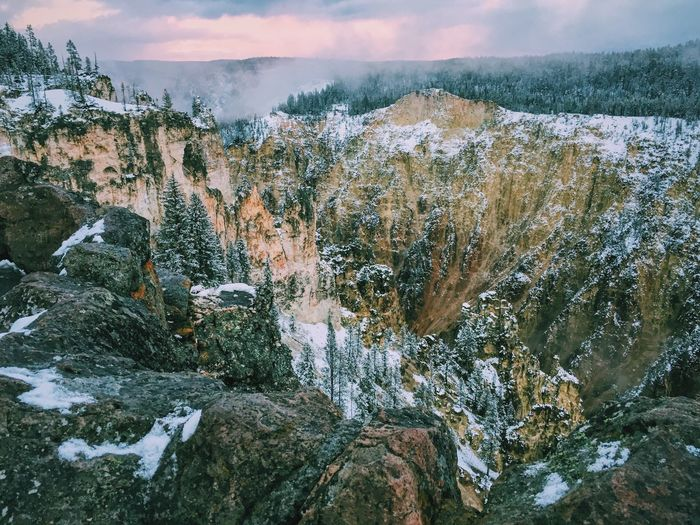 Scenic view of grand canyon of the yellowstone against cloudy sky during winter season