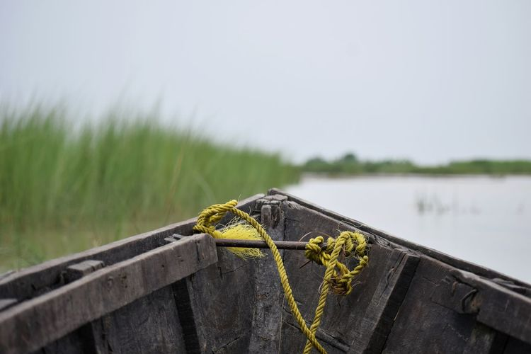 Close-Up Of Wooden Boat In Lake