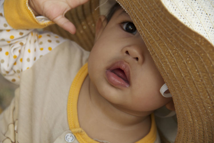 Hat Infant Photography Love Boys Childhood Close-up Cute Cute Girl Day Elementary Age Front View Human Hand Indoors  Infant Leisure Activity Lifestyles Model Model Pose Modeling People Real People Straw Hat