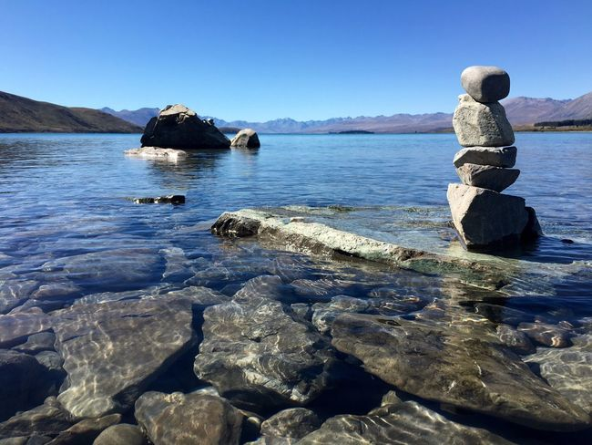 Water Scenics Tranquil Scene Sea Clear Sky Leisure Activity Vacations Rock - Object Beauty In Nature Tranquility Nature Blue Non-urban Scene Tourism In Front Of Rock Formation Day Outdoors Mountain Lake
