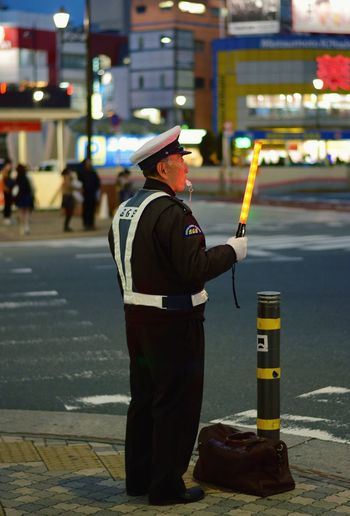 """Travel Traveling Focus On Foreground Protection Standing Protective Workwear Men Uniform One Person Outdoors People Headwear One Man Only Lamp Tokyo,Japan Tokyo Street Photography Tokyo Tokyo Night Tokyo, Japan Tokyonight Jedi Jedimaster Starwars """"Luke i'm your father"""" Tokyo,Japan"""