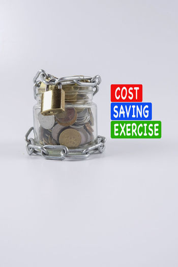 COST SAVING EXERCISE concept Exercise Chain Close-up Cut Cost Expenses Inflation  Key No People Reduction Saving White Background