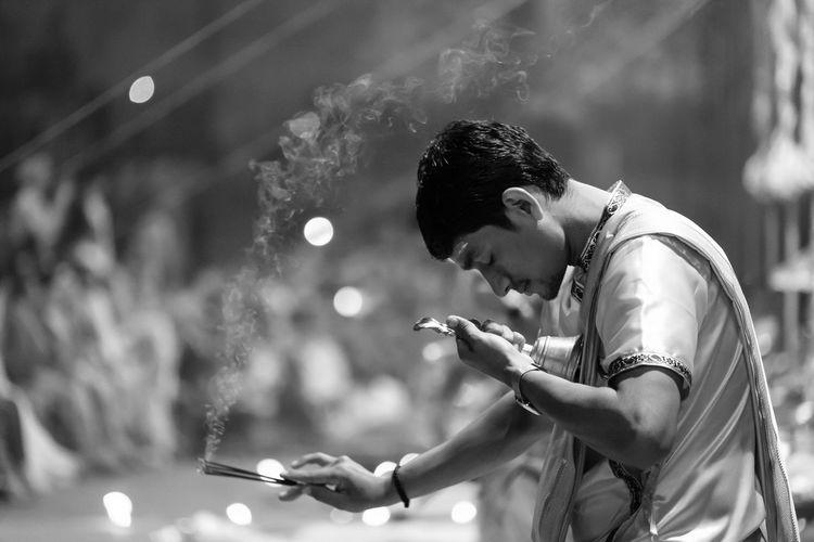 Night sacrifice Ganges River India Pray Smoke Arts Culture And Entertainment Black And White Casual Clothing Day Focus On Foreground Holding Leisure Activity Lifestyles Outdoors Performance Playing Real People Sacrifice Skill  Young Adult