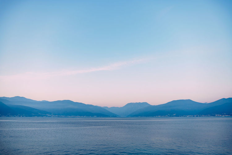 Scenic view of mountains against blue sky during sunset