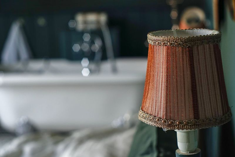 Close-up of lamp on table