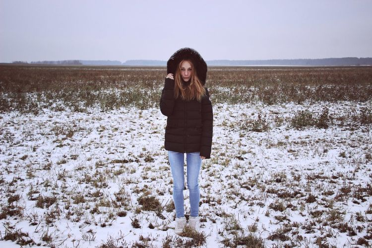 Portrait Of Woman Standing In Field During Winter