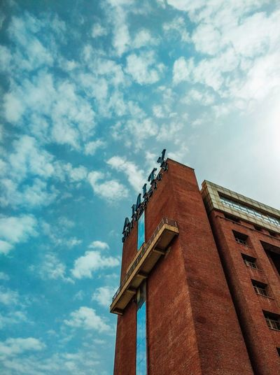 Building Building Exterior Architecture Symmetry Structure Sky Blue Clouds HDR College University Weather Windy