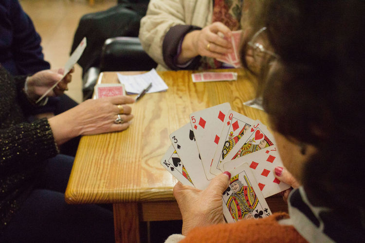 Women Playing Card Game At Table