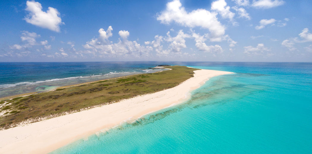 🏝️The most beautiful ialand i've ever seen🏝️~ Sea Beach Sand Scenics Sky Idyllic Beauty In Nature Cloud - Sky Outdoors Nature Water Day Blue Coastline Tranquility Beauty In Nature Travel Destinations Turksandcaicos Grandturk Paradise
