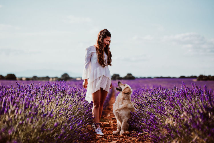 Woman with dog on lavender field