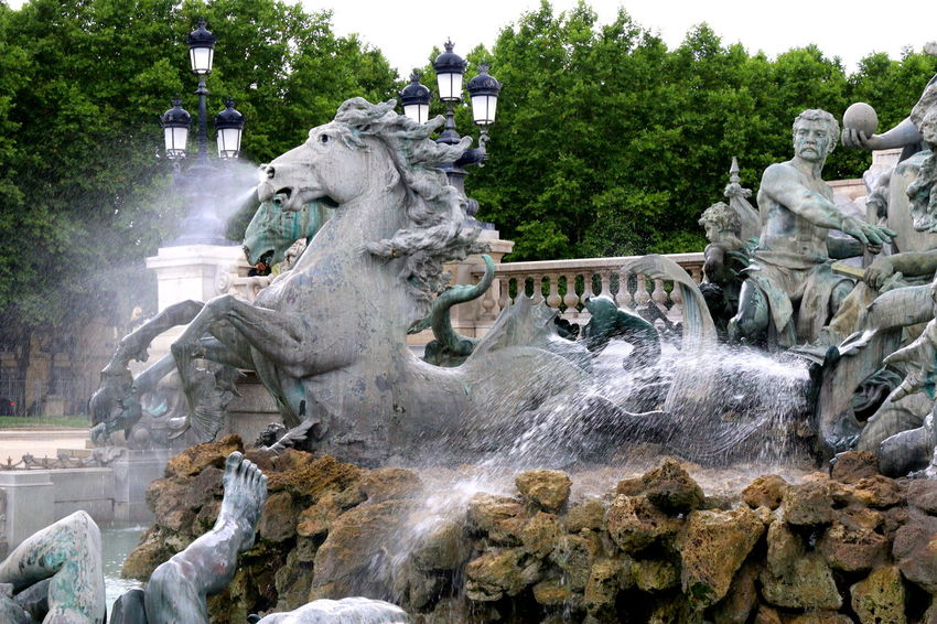 Bordeaux Bordeaux, France Girondins De Bordeaux Horses Quinconces Architecture Art And Craft Building Exterior Creativity Day Fountain Girondins Human Representation Long Exposure Motion No People Outdoors Sculpture Sky Splashing Spraying Statue Tree Water Waterfall