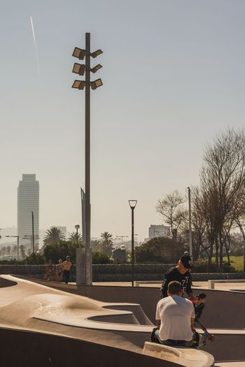 Full Length Two People People Friendship Outdoors Men Adult Nature Young Adult Sky Day Scooter Skyscraper Skate Park Summer Views Skyline Lifestyles Street Photography Palm Tree Skatepark Barcelona City Portrait Of A City Skateboarding Skate Photography The Street Photographer - 2017 EyeEm Awards