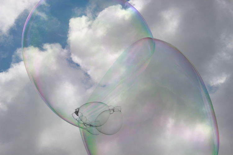 Dreams & Bubbles flying high Beauty In Nature Bubble Bubble Wand Close-up Cloud - Sky Day Fragility Nature No People Outdoors Rainbow Sky Spectrum