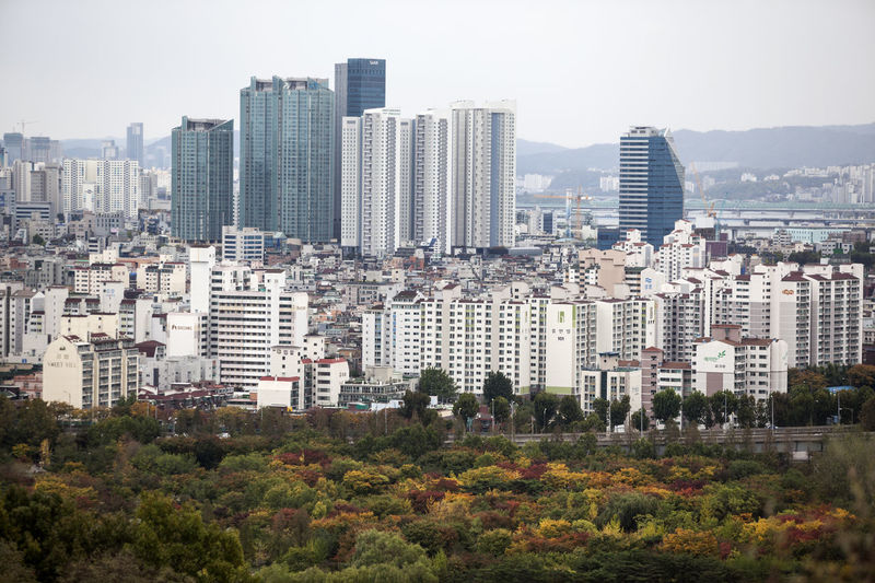 I was in Haneulgongwon which means sky park. It was cloudy in the morning and rainy in the afternoon. Architecture Autumn Building Exterior Business Finance And Industry City City Life Cityscape Crowded Day Downtown District Fall Office Building Exterior Outdoors People Sky Skyscraper Travel Destinations Urban And Rural Urban Skyline