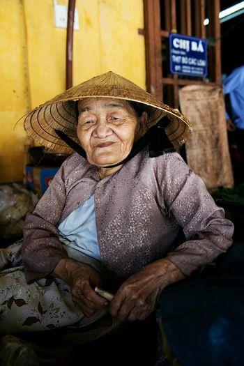 Portrait of senior woman sitting outdoors