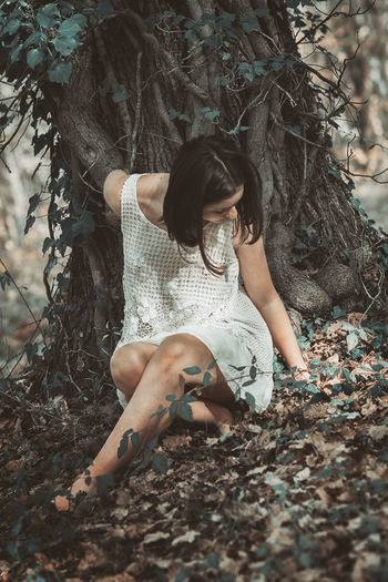 The trunk Girl Beauty In Nature Portrait Nature Outdoors Freshness Still Life White Dress Low Section Full Length Women barefoot Tree Human Leg