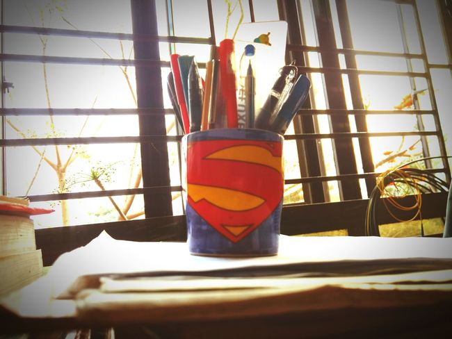 Cups Close-up No People Indoors  Multi Colored Day Cup Pen Pen Stand Superman Logo Study Studytime Evening