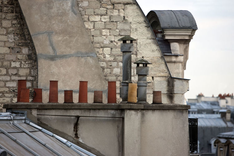 Cimneys in Paris Architecture Building Exterior Built Structure Ceramics Chimneys Cimney Creativity Exterior France Old Paris Roof Sky Wall