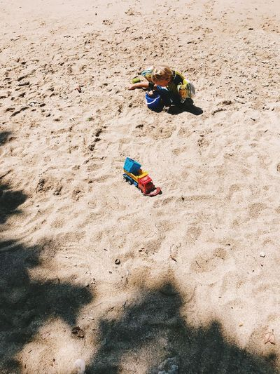 Sand Land Toy Beach Childhood Leisure Activity Playing Real People Nature High Angle View Day Child Sunlight Lifestyles Men Vacations Trip Boys Outdoors Enjoyment Innocence