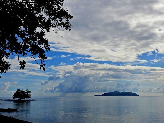 Ternate Island from Halmahera Beach Beauty In Nature Cloud - Sky Halmahera Island Lansdcape Molucas Mountain Sea Sky And Clouds