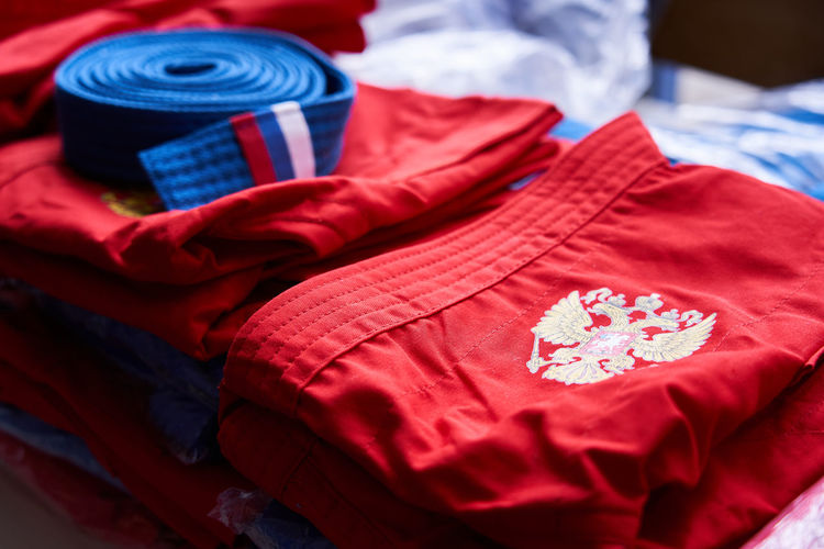 Sport uniform with coat of arms of russian federation folded and lying on the table