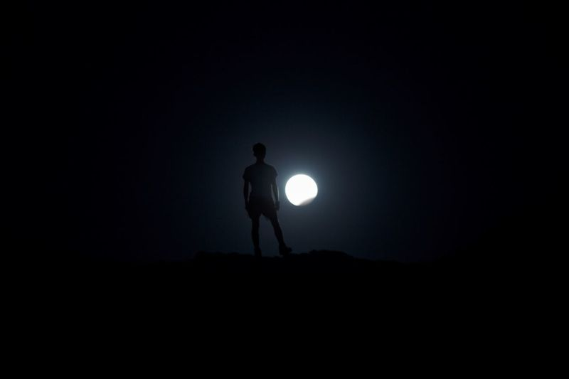 Silhouette man standing at night