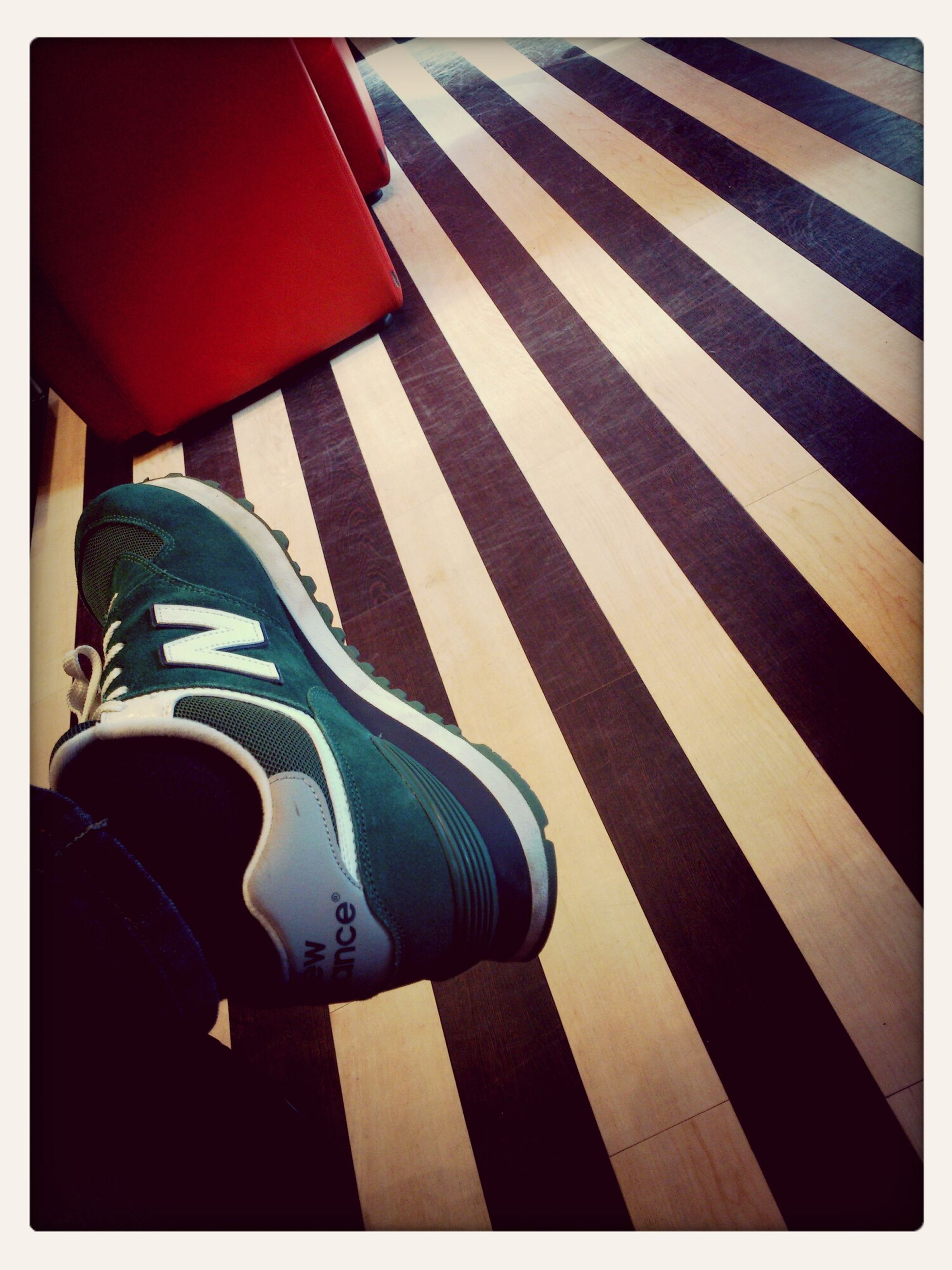 transfer print, low section, auto post production filter, person, high angle view, shoe, lifestyles, red, standing, striped, footwear, leisure activity, men, shadow, sunlight, day, indoors, jeans