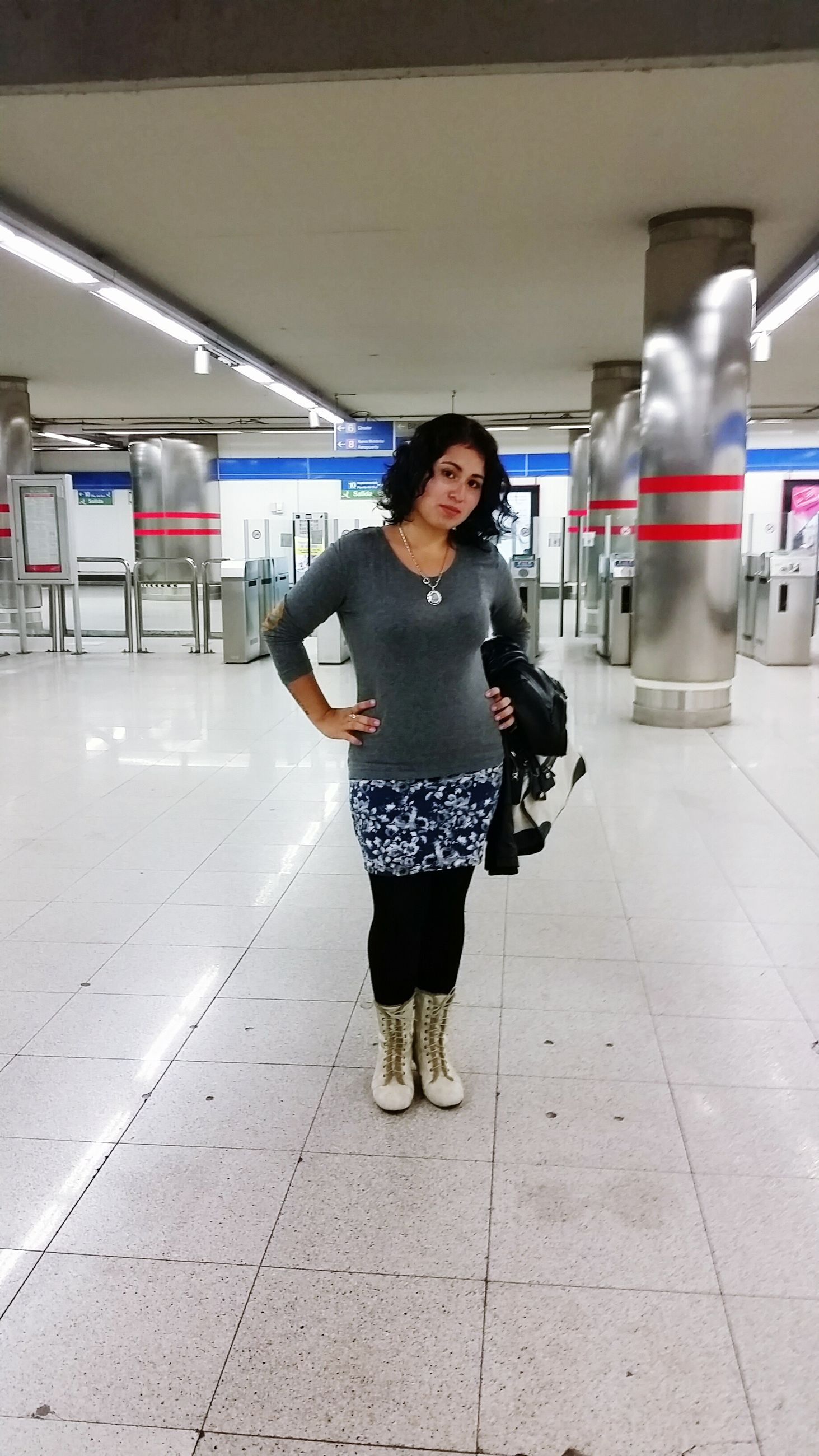 lifestyles, indoors, casual clothing, young adult, full length, portrait, person, leisure activity, looking at camera, front view, standing, young women, smiling, transportation, illuminated, tiled floor, travel