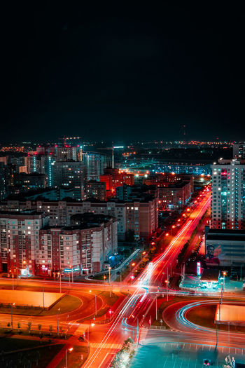 Mood Illuminated City Night Architecture Motion Building Exterior City Life Long Exposure Built Structure Cityscape Transportation Light Trail Street Road Speed Sky No People Blurred Motion Traffic City Street Office Building Exterior Outdoors Skyscraper