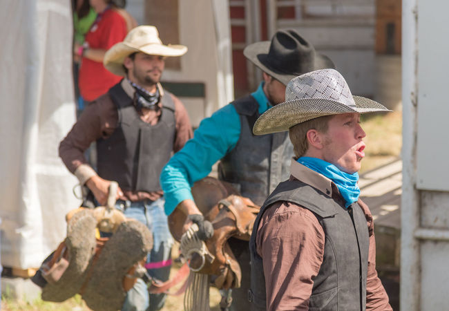 Williams Lake, British Columbia/Canada - July 2, 2016: a team of cowboys prepare to walk into the arena for the Wild Horse Race at the 90th Williams Lake Stampede 90th Williams Lake Stampede Arena Behind The Scenes British Columbia, Canada Cariboo Chilcotin Cowboys Growth Rodeo Rugged Travel Wild Horse Race Candid Cheering Competition Country Western Cowboy Hat Documentary Editorial  Men Outdoors People Professional Rodeo Stampede Team Tourism